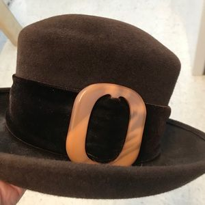 Burberry brown hat by Peter Bettley. $350